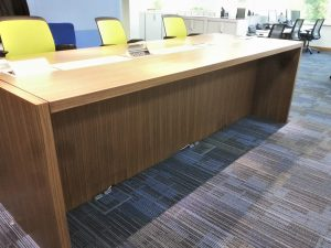Bespoke workstations with fold down plugs